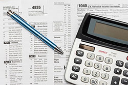 image of tax forms and calculator